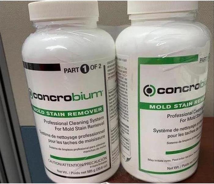 two bottles of concrobrium mold stain remover