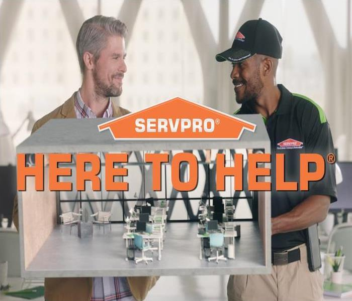 SERVPRO Logo with text, Here to Help, over image of client and technician holing a model of an office space